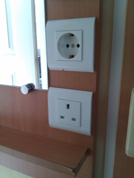 UK and continental power sockets existing happily side-by-side, just like their respective countries within the EU. (Stop laughing at the back!)